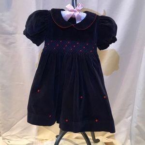 Navy blue velvet dress with smocked bodice